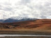 Вода, тундра, снег в горах
